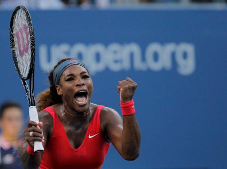 Serena Williams elebrates after defeating Li Na at the U.S. Open tennis championships in New York