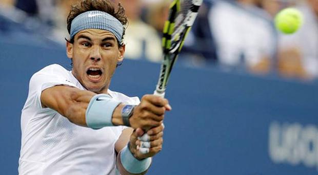 Rafael Nadal, of Spain, returns a shot to Richard Gasquet, of France, during the semifinals of the 2013 U.S. Open tennis tournament.
