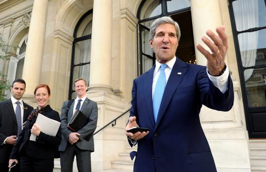 US Secretary of State John Kerry talks to reporters at the United States embassy in Paris before his meeting with Arab League representatives