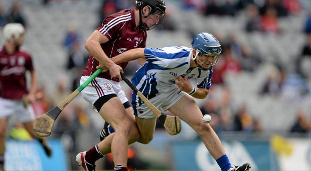 Patrick Curran, Waterford, in action against Darragh O'Donoghue