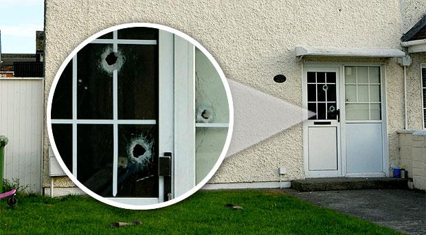 Bullet holes in the door of the family home in Finglas