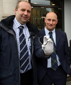 David Taylor (left) with his brother in-law Andrew Coulter, from Kircubbin, Co Down, with the rare Viking silver ring he discovered on his brother in-law's farm, outside a special treasure trove inquest hearing at Belfast coroner's court.