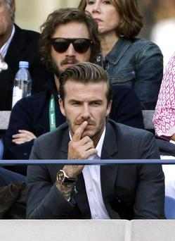 David Beckham watches play between Rafael Nadal, of Spain, and Novak Djokovic, of Serbia, during the men's singles final of the 2013 U.S. Open tennis tournament