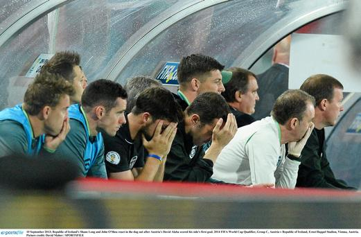 Republic of Ireland's Shane Long and John O'Shea react in the dug out after Austria's David Alaba scored his side's goal. Picture credit: David Maher / SPORTSFILE