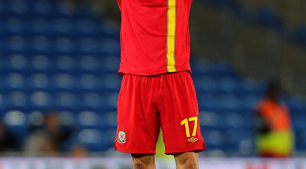 Wales' Gareth Bale reacts during the FIFA World Cup Qualifying match against Serbia at Cardiff City Stadium, Cardiff