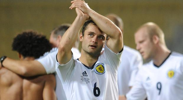 Scotland's Shaun Maloney celebrates at the end of the FIFA World Cup Qualifying match at the Phillip II Arena, Skopje, Macedonia. PRESS ASSOCIATION Photo. Picture date: Tuesday September 10, 2013. See PA story SOCCER Scotland. Photo credit should read: Joe Giddens/PA Wire. RESTRICTIONS: Use subject to restrictions. Editorial use only. Commercial use only with prior written consent of the Scottish FA. Call +44 (0)1158 447447 for further information.