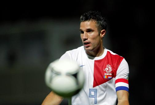 Netherlands's player Robin van Persie gestures during their World Cup qualifying round soccer match against Andorra this evening
