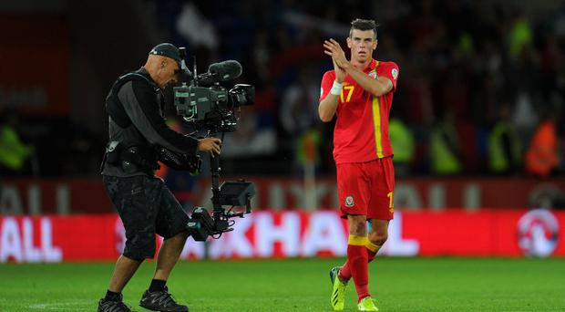 Gareth Bale applauds the crowd after the FIFA 2014 World Cup Qualifier Group A match between Wales and Serbia at Cardiff City Stadium