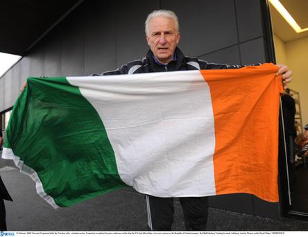 Giovanni Trapattoni holds the Tricolour after a training session. Trapattoni revealed at the news conference earlier that the FAI had offered him a two year contract as the Republic of Ireland manager