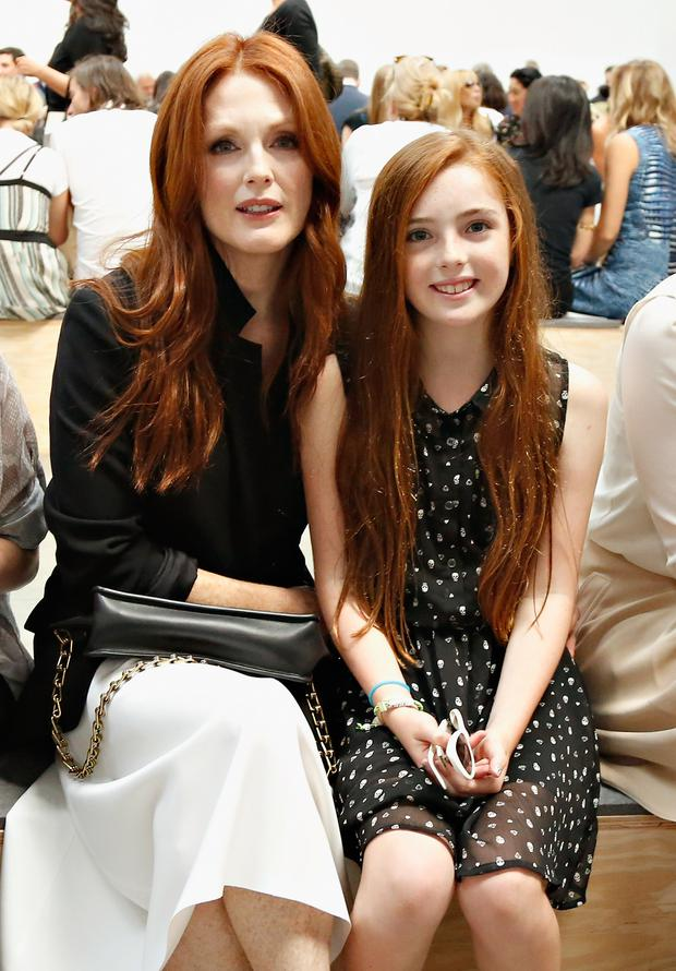 Actress Julianne Moore and her daughter Liv Helen Freundlich attend the Reed Krakoff fashion show during Mercedes-Benz Fashion Week Spring 2014 on September 11, 2013 in New York City. (Photo by Cindy Ord/Getty Images)