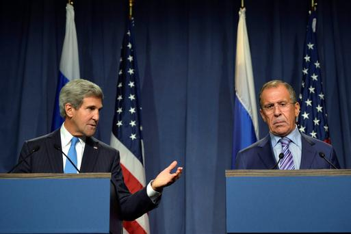U.S. Secretary of State John Kerry speaks next to Russian Foreign Minister Sergey Lavrov, right, during a press conference before their meeting to discuss the ongoing crisis in Syria, in Geneva, Switzerland