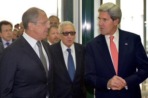 Sergei Lavrov, Russian Foreign Minister, left, Lakhdar Brahimi, UN Joint Special Representative for Syria, center, and John Kerry, US Secretary of State, right, arrive for a meeting to discuss the issue on Syrian chemical weapons at the European headquarters of the United Nations in Geneva, Switzerland