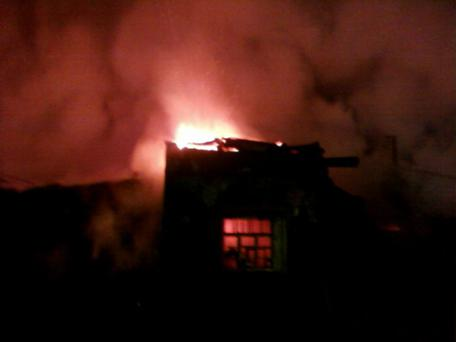 A general view of a psychiatric hospital on fire in the Novgorod region town of Luka