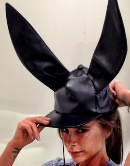 Victoria gave a shout-out to her fellow 'fashion buddies' as she posed with an eye-catching black leather Comme de Garcons rabbit ears hat.