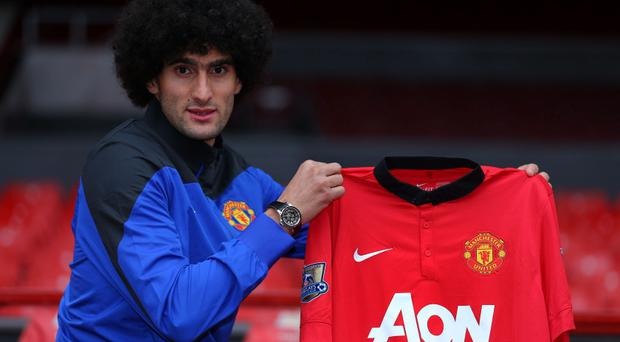 New Manchester United signing Marouane Fellaini during a photocall at Old Trafford, Manchester, today