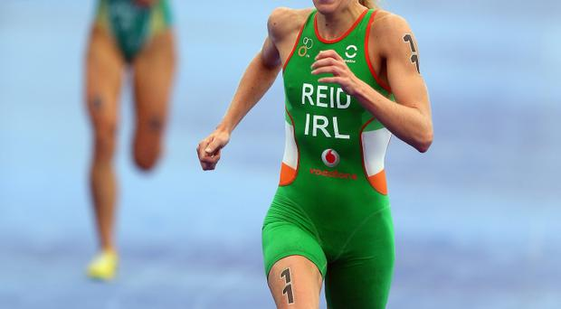 Aileen Reid of Ireland crosses the finish line to take second place in the Pruhealth World Triathalon Grand Final at Hyde Park today