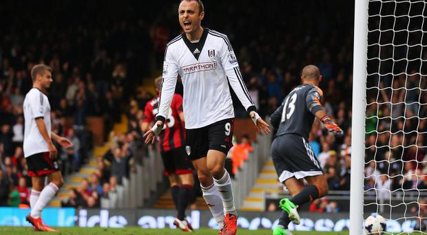 Dimitar Berbatov of Fulham reacts after his goal was disallowed during the Barclays Premier League match between Fulham and West Bromwich Albion at Craven Cottage