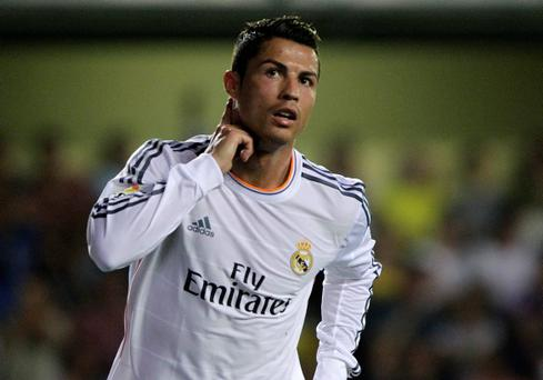 Real Madrid's Cristiano Ronaldo celebrates after he scored against Villarreal during their Spanish first division soccer match at the Madrigal stadium in Villarreal, September 14, 2013. REUTERS/Heino Kalis (SPAIN - Tags: SPORT SOCCER)