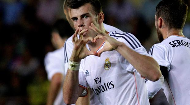 Real Madrid's Gareth Bale celebrates after he scored on his debut against Villarreal