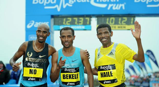Great Britain's Mo Farah (left), Ethiopa's Kenenisa Bekele (centre) and Ethiopia's Haile Gebrselassie after the 2013 BUPA Great North Run in Newcastle