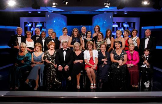The 2013 recipients of the 39th Annual People of the Awards Ceremony organised by Rehab pictured on stage with Ceremony host Grainne Seoige, An Taoiseach Enda Kenny, Angela Kerins, CEO of Rehab, Minister Frances Fitzgerald and Minister Joan Burton after the awards ceremony held in the CityWest Hotel, Co. Dublin. Pic. Robbie Reynolds