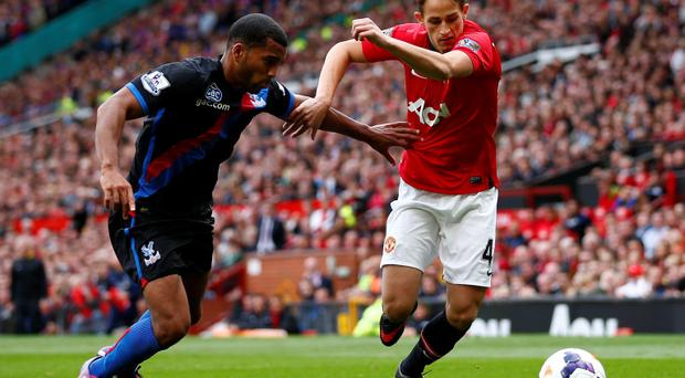 Crystal Palace's Adrian Mariappa (L) challenges Manchester United's Adnan Januzaj on Saturday