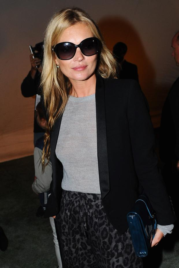 Kate Moss attends the Unique show during London Fashion Week SS14 at TopShop Show Space on September 15, 2013 in London, England. (Photo by Samir Hussein/Getty Images)