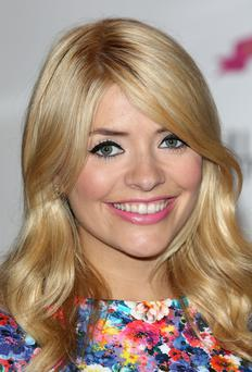 Holly Willoughby is stepping down from her role as co-host of talent show The Voice to concentrate on her family. (Photo by Tim P. Whitby/Getty Images)