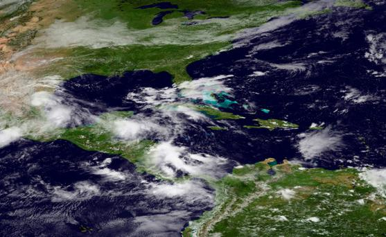 Mexico, Central America and the Caribbean region are pictured in this NASA satellite handout photo, which shows the remains of Tropical Storm Ingrid on the east coast of Mexico.