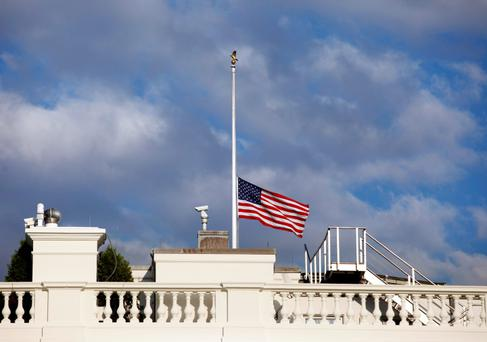 A U.S. flag flies at half staff at the White House September 16, 2013 in remembrance of victims of a shooting in the U.S. Navy Yard in Washington. REUTERS/Yuri Gripas