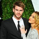 Actress/singer Miley Cyrus and actor Liam Hemsworth