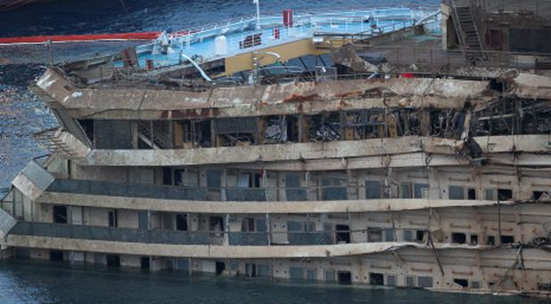 A detail of the right side of the Costa Concordia is seen after it was lifted upright on the Tuscan Island of Giglio, Italy, early on Tuesday morning, September 17