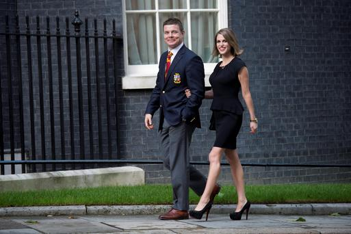 Brian O'Driscoll and his wife Amy Huberman arrive for a reception for the British and Irish Lions with Prime Minister David Cameron at 10 Downing Street