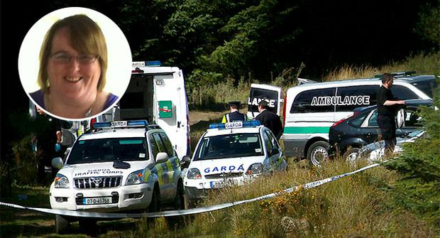 Garda at the scene at Kilakee Mountain Rathfarnham where human remains where discovered.