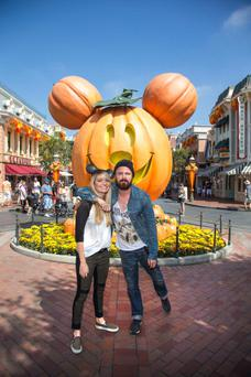 Aaron Paul and his wife Lauren Parsekian celebrate 'Halloween Time' at Disneyland