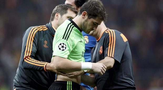 Real Madrid's goalkeeper Iker Casillas is treated during the Champions League Group B soccer match against Galatasaray at Turk Telekom Arena in Istanbul