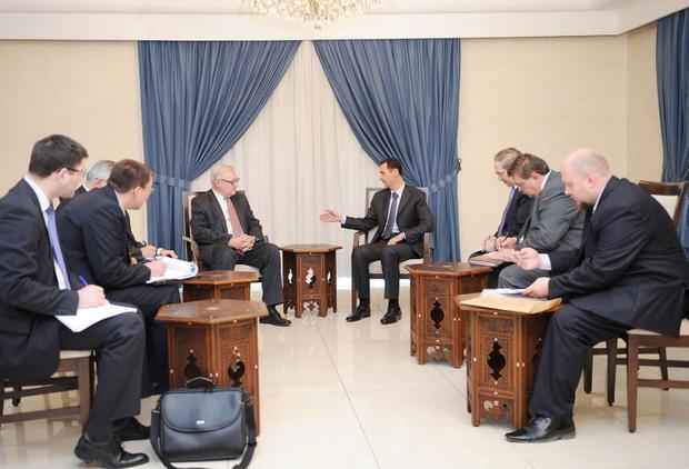 Syria's President Bashar al-Assad (centre, on R) meets Russian deputy Foreign Minister Sergei Ryabkov (centre, on L) in Damascus