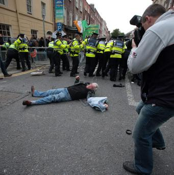 Gardai engage with protesters outside the Dail this evening. Photo: Collins
