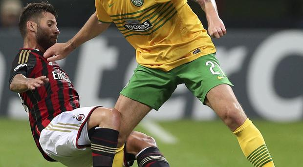 Celtic's Charlie Mulgrew, right, is tackled by AC Milan's Antonio Nocerino during the Champions League group H soccer match between AC Milan and Celtic