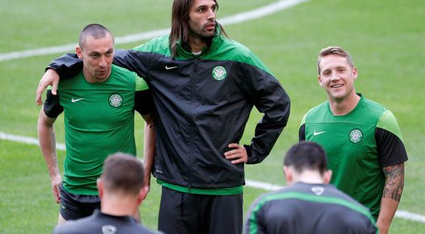 Celtic's Georgios Samaras (C) stands with teammates Scott Brown (L) and Kris Commons