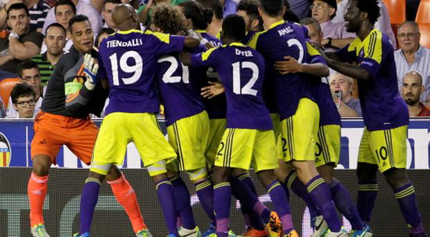 Swansea City's players celebrate a goal against Valencia during their Europa League soccer match at the Mestalla stadium in Valencia