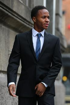 Liverpool and England footballer Raheem Sterling, 18, from Woolton, arrives at Liverpool Magistrates' Court, where he is to stand trial on charges of assaulting a woman, reported to be his girlfriend. PRESS ASSOCIATION Photo. Picture date: Friday September 20, 2013. The winger entered a not guilty plea at Liverpool Magistrates' Court last month and is said to have attacked 19-year-old model Shana Ann Rose Halliday. See PA story COURTS Sterling. Photo credit should read: Dave Thompson/PA Wire
