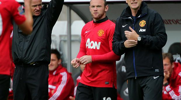 Manchester United manager David Moyes (right) and Wayne Rooney