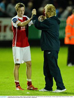 St Patricks Athletic manager Liam Buckley celebrates with Chris Forrester at the end of the game