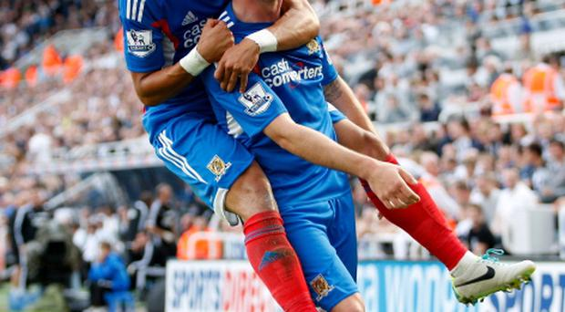 Hull's Robbie Brady and Liam Rosenior celebrate thier sides openind goal against Newcastle
