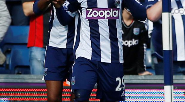West Bromwich Albion's Stephane Sessegnon (R) celebrates his goal against former club Sunderland with Nicolas Anelka