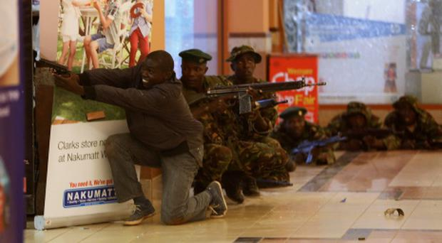 Soldiers and armed police hunt gunmen who went on a shooting spree in Westgate shopping centre