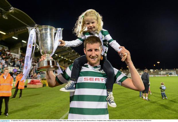 Jason McGuinness, Shamrock Rovers, celebrates with his 3 year old daughter Abbie after the game