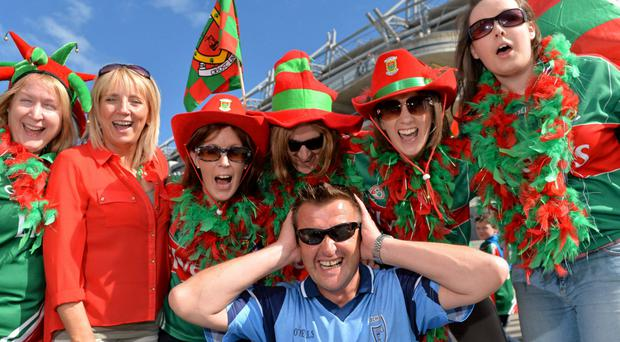Dublin supporter Darragh Monahan is surrounded by Mayo supporters, ahead of the GAA Football All-Ireland Championship Finals, Croke Park, Dublin.
