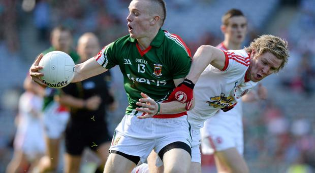 Darragh Doherty , Mayo, in action against Frank Burns